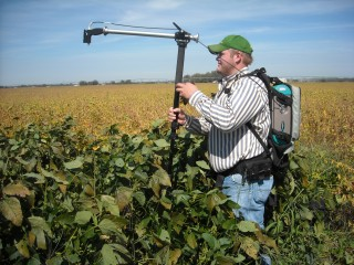 Kansas State University's Brent Christenson, a graduate student in the Department of Agronomy, takes remote sensing readings on soybean last summer.