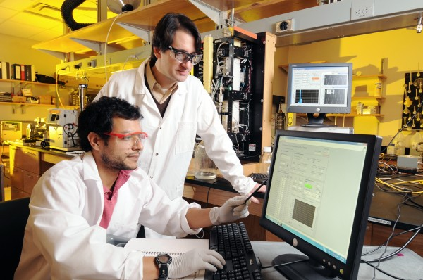 Georgia Tech professor Athanasios Nenes is shown with graduate research assistant Ricardo Morales Betancourt analyzing droplet samples produced with a cloud formation chamber.