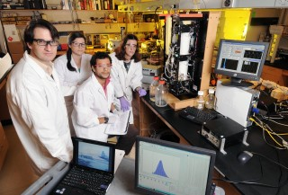 Georgia Tech researchers pose with a cloud formation chamber and related analysis equipment in the laboratory of professor Athanasios Nenes. Nenes is shown...