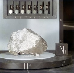 "Called the ""Genesis Rock,"" this lunar sample of unbrecciated anorthosite collected during the Apollo 15 mission was thought to be a piece of the moon's..."