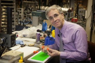 University of Virginia physicist Lou Bloomfield with a new type of silicone rubber he has developed, called Vistik.