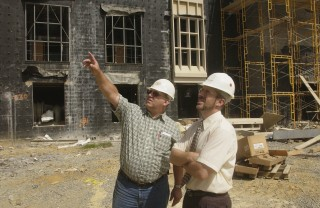 Brian Kleiner, right, director of the Myers–Lawson School of Construction at Virginia Tech, visits a construction site.