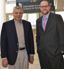 Gallagher with contest judge Raafat Fahmy PhD, FDA science advisor.)