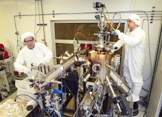 Inside a clean room, Brookhaven physicists Ivan Bozovic (left) and Anthony Bollinger work on the molecular beam epitaxy system that produced the atomically...