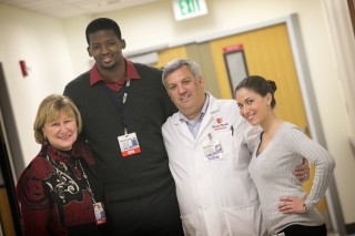 Lesego Andrew Goba with Lee Anne Xippolitos, dean of the Stony Brook University School of Nursing (left), and his colleagues, Drs. David Margulies and Fiana...
