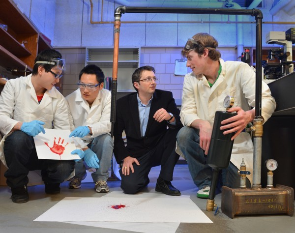 A research team led by Daniel Attinger of Iowa State University is developing instruments that produce controlled bloodstain patterns. The team includes, left to right, Ying Xing, Jin Xu, Attinger and Miles Hayes.