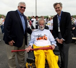 Swinging a Big Stick: Stony Brook Medicine's Dr. Reuven Pasternak, left, and Dr. Kenneth Kaushansky, presented 20-year ALS patient advocate Christopher...