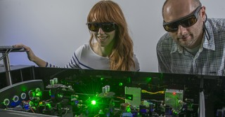 Graduate student Michelle Harris and research scientist Darek Niedzwiedzki in PARC's Ultrafast Laser Facility. The laser setup allows them to measure...