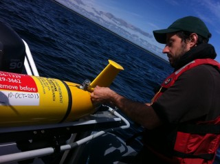 Ocean Tracking Network research assistant, Adam Comeau, checks glider instrumentation before glider deployment.