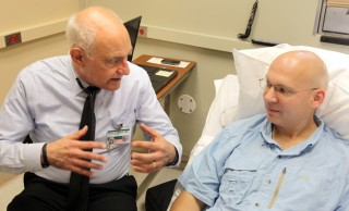William Russell, M.D., left, talks with participant Ric Hudgens at the Vanderbilt Eskind Diabetes Clinic about a new study examining the ability of the drug...