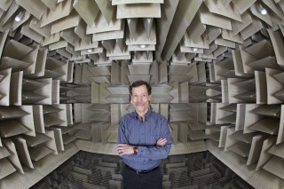 Binghamton University Distinguished Professor Ron Miles poses inside the University's new anechoic chamber.