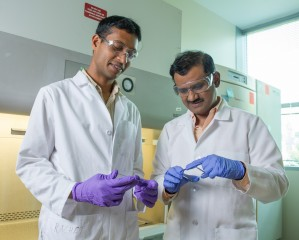 Dr. Krishnendu Roy (right) and Rachit Agarwal examine a silicon wafer.