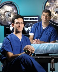 Pediatric neurologist Adam Hartman, left, and neurosurgeon George Jallo, two members of a multidisciplinary team that evaluates and treats patients with...