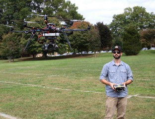 Graduate biology student Max Messinger flies a robotic drone equipped with a visible light camera on the campus of Wake Forest University.