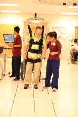 Stroke patient at Univ. of Maryland Rehabilitation & Orthopaedic Institute uses robotic body weight support system in therapy.