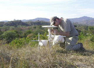 Andrew Newman, an associate professor in the School of Earth and Atmospheric Sciences at the Georgia Institute of Technology, performs a GPS survey in Costa...