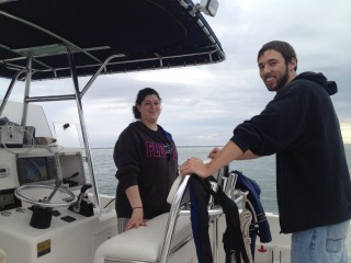 Students Cayla Dean and Bryan Hamilton on a Research Vessel