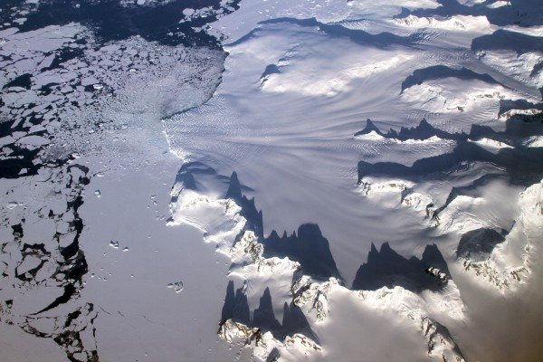 The gradual warming of the North and Tropical Atlantic Ocean is contributing to climate change in Antarctica, a team of NYU scientists has concluded. The findings, which rely on more than three decades of atmospheric data, show new ways in which distant regional conditions are contributing to Antarctic climate change. Below, several glaciers in the Antarctic Peninsula pass between sharp mountain peaks and converge in a single calving front, as seen by Operation IceBridge while returning from a survey of the Ronne Ice Shelf on Nov. 1, 2012. NASA's Operation IceBridge is an airborne science mission to study Earth's polar ice. For more information about IceBridge, visit: www.nasa.gov/icebridge.