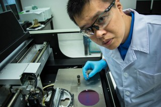 Dr Zheng Jian, the first author of the paper, demonstrating the printing of molybdenum disulfide flakes from a solution of the exfoliated flakes.
