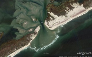 Aerial view showing the new inlet on New York's Fire Island and large areas of sand pushed over vegetation by Hurricane Sandy. Image generated from Google...