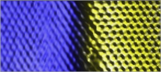 ORNL and UT researchers have invented a method to merge different 2-dimensional materials into a seamless layer. This colorized scanning tunneling microscope...