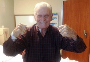 Patient Clifford Reed celebrates one day after his aortic valve was replaced.