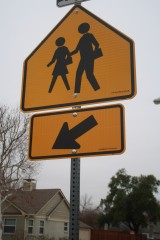 Sidewalks and street signs help make communities a safer place to walk.