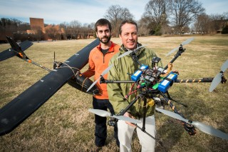 Wake Forest biology graduate student Max Messinger ('13) and biology professor Miles Silman pose with their remote controlled helicopter and fixed-wing...