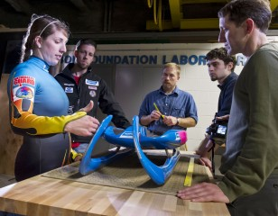 Left to right: Olympian Erin Hamlin and Duncan Kennedy of the United States Luge Association work with Prof. Doug Bohl, grad student Brian Heckendorf,...