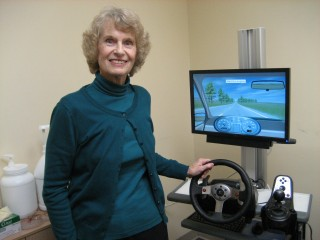 Hip replacement patient with interactive driving simulator.