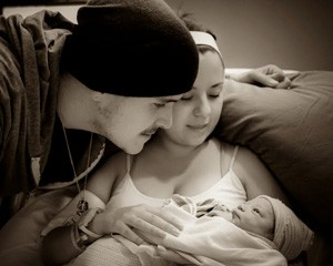 Amanda and her husband, Nathan, doting on their beautiful daughter, Kassidy, minutes after her arrival.