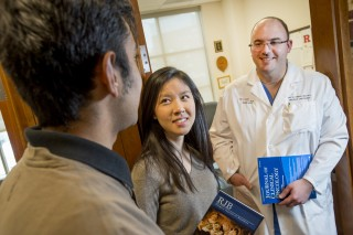 Neil Raju, a senior in the School of Engineering, and Julia Xia, a junior in the School of Arts and Sciences, speak with surgeon Eric Singer after attending...
