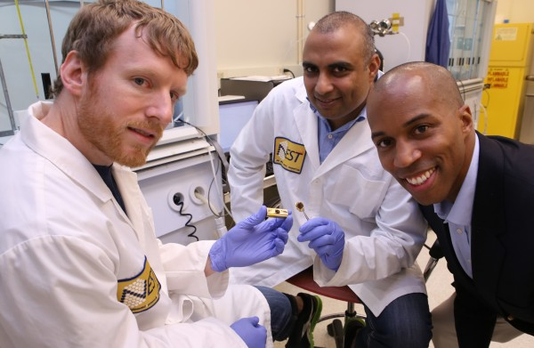 Georgia Tech researchers have developed a polymer material that can reliably conduct heat from electronic devices. Shown (l-r) are Thomas Bougher, a Ph.D. student in the George W. Woodruff School of Mechanical Engineering, Virendra Singh, a research scientist in the Woodruff School, and Baratunde Cola, an assistant professor.