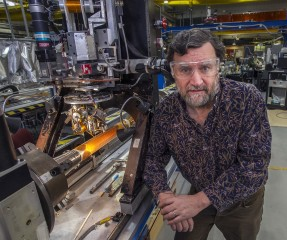 Brookhaven Lab accelerator physicist Stephen Peggs with magnet technology that could reduce the size of particle accelerators needed to steer heavy ion beams...