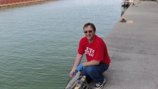 Dr. Jerry Kavouras of Lewis University conducts research on Lake Michigan.
