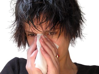Image of woman blowing nose