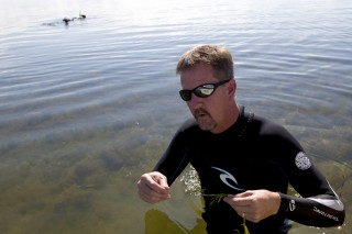Tom Frazer, a professor of aquatic ecology and director of the School of Natural Resources and Environment at UF/IFAS, looks for seagrass in Florida's...