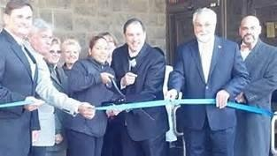 Ribbon cutting when MyTown Marketplace opened after receiving state funding