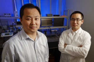 Virginia Tech chemical engineer Chang Lu,  and his graduate student Zhenning Cao, right, are pictured in the lab.