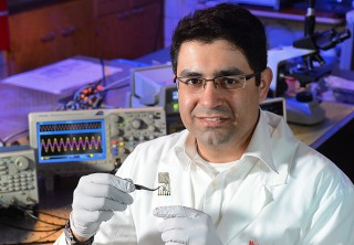 Iowa State's Reza Montazami examines a degradable antenna capable of data transmission.