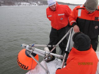 Great Lakes Research Center staff deploy the cabled under-ice observatory.