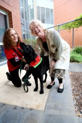 From left: Delta Therapy Dog handler and University of Adelaide Masters in Health Psychology student Marie Dow, with her dog Nilfisk, who regularly visits...