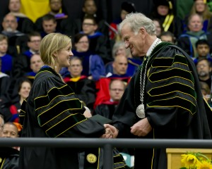 Clarkson University President Tony Collins (right) congratulates Avery Bang upon receipt of her honorary degree.