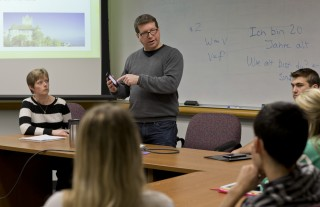 Above, Clarkson University professors Sandra Fisher (left) and Michael Wasserman (standing) teach a class at Clarkson for business students traveling to Europe...
