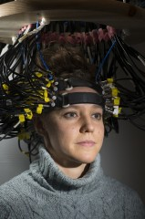 Research participant Britt Gott wears a cap used to image the brain via diffuse optical tomography.