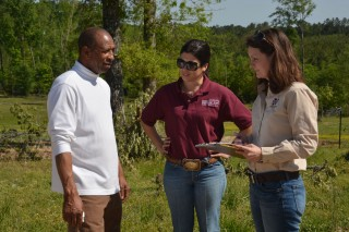 Winston County farmer Willie Lee Jr. discusses his losses from the April 28 tornado with Mississippi State University Extension Service disaster assessment...