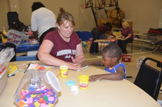 Gina Carr, a Mississippi State University Extension Service staff member with the Mississippi Child Care Resource and Referral Network, keeps 3-year-old...