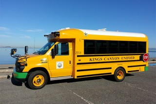 Electric school buses, such as the Trans Tech model shown here, could save school districts millions if integrated with a vehicle-to-grid system, according...