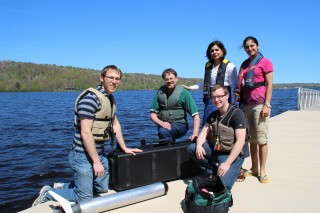 Nina Mahmoudian, standing second from right, and her team of student researchers on the Michigan Technological University waterfront prepare to launch...