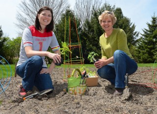 Planting a garden is just one option that Erin Bergquist (left) and Linda Naeve recommend for people interested in local foods.